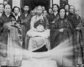 The Master in a Group Portrait. The photo reveals a vajra-shaped light supporting the Master